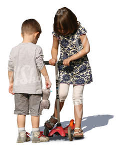 boy and girl playing together with a scooter