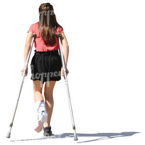 young girl walking with crutches