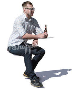 man sitting in a cafe and drinking beer