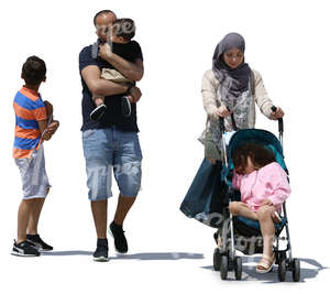 muslim family of five taking a walk