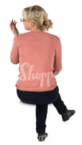 woman sitting seen from behind