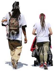 man and woman walking with a baby