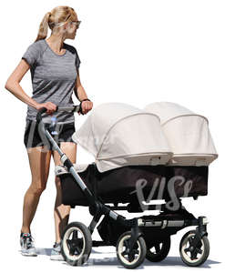 woman walking with a twins carriage