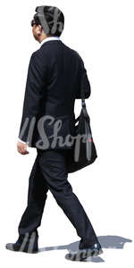 asian businessman in a black suit walking