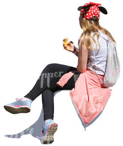 girl sitting and eating ice cream
