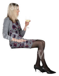 woman sitting in a cafe and drinking white wine