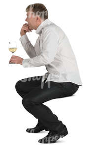 man sitting in a cafe and drinking white wine