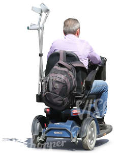 elderly man riding a scootmobile