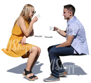 couple sitting in a cafe and drinking coffee