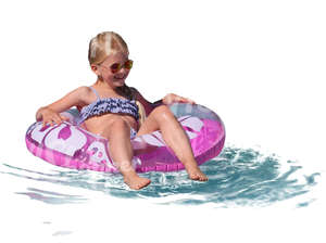 young girl floating with a swimming ring