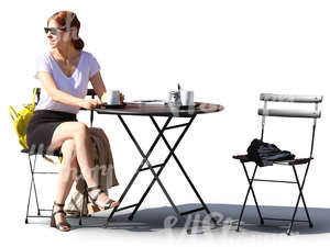woman sitting in a street cafe