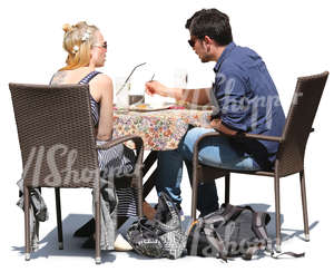 man and woman sitting in a cafe and eating