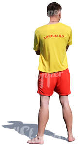 lifeguard standing on the beach
