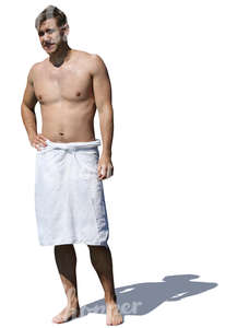 man with a towel standing in sunlight
