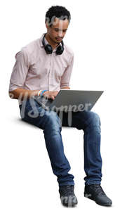 african man sitting and working with a laptop