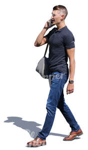 man walking and talking on a phone