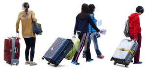 four asian women travelling with big suitcases