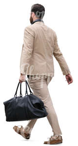 man in a beige suit carrying a bag