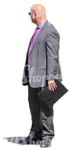 businessman with a pink tie standing