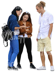 group of three people standing and looking at smth on the phone