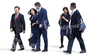 group of asian businessmen and businesswomen walking