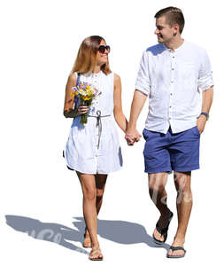 smiling couple walking hand in hand