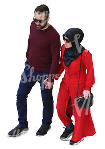 muslim couple walking hand in hand seen from above