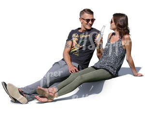 man and woman sitting on the terrace and talking