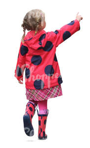 little girl in a red raincoat walking and pointing at smth