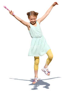 young girl in a summer dress jumping in the air