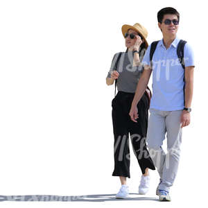 backlit asian couple walking on the street