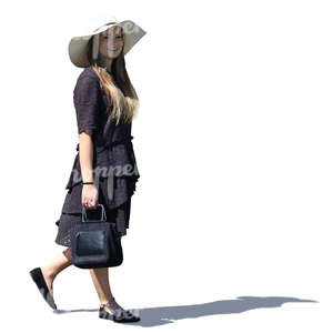 backlit woman in a black summer dress walking