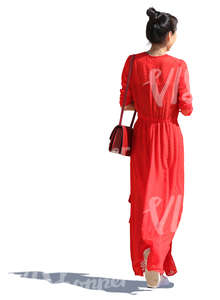 asian woman in a long red dress walking