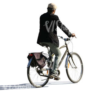 backlit man riding a bike
