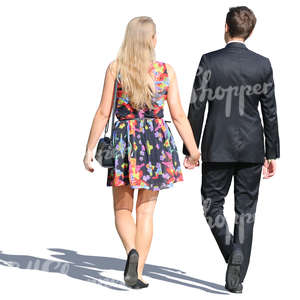man and woman in formal outfits walking hand in hand