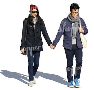 young asian couple walking hand in hand