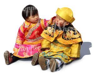 two chinese children sitting on the ground