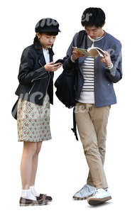 young asian couple standing and checking for directions