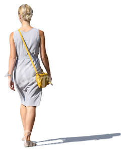 woman in a grey summer dress walking