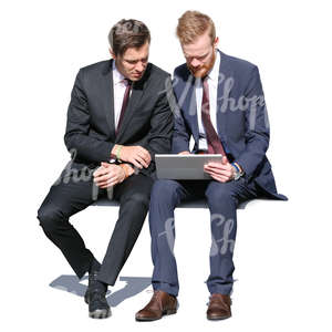 two businessmen sitting and looking at a tablet