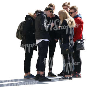 group of six young people standing and looking at smth
