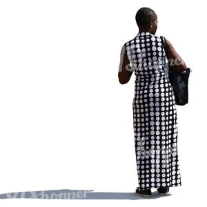 african woman in a long monochrome dress stanting