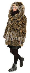 woman in hooded fur coat walking