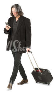 man with a suitcase walking and checking his phone