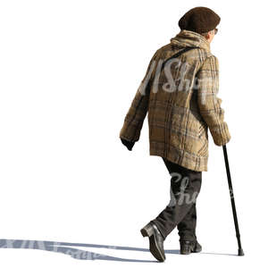 elderly woman walking with a walking stick