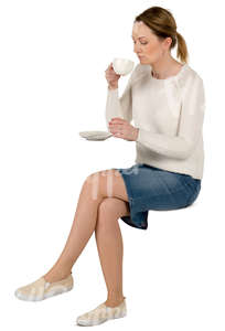 woman sitting in a cafe and drinking coffee