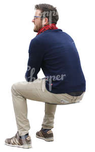 man sitting seen from back angle