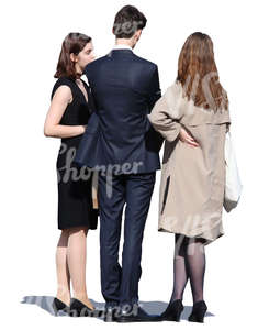 group of three people in formal clothing standing and talking