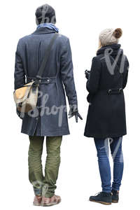 man and woman in autumn coats standing