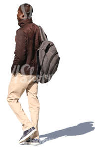 african man with a backpack walking